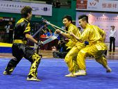 KUALA LUMPUR - NOV 05: Hong Kong's dalian team performs a fight scene in the Men's Dual Event at the