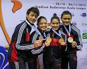 KUALA LUMPUR - NOV 03: Members of the Malaysian Wushu team show off their medals after the Presentat