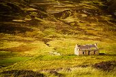 stock photo of stone house  - Little abandoned stone house in a middle of a mountain in the Cairngorms - JPG
