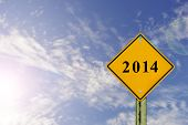 image of benchmarking  - Road sign to 2014 with blue sky backgroundhappy new year 2014 - JPG
