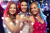 new year, celebration, friends, bachelorette party, birthday concept - three beautiful woman in even