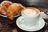 stock photo of croissant  - hot Cappuccino and croissant with coffee beans - JPG