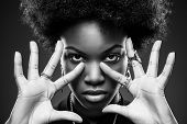 stock photo of afro hair  - Young black woman with afro hair style - JPG