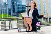 stock photo of breakdown  - Junior executive leader of company doing yoga for relaxation - JPG