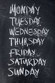 image of weekdays  - Conceptual weekdays list written on black chalkboard blackboard - JPG