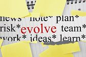 stock photo of evolve  - The word evolve against sticky notes strewn over notepad - JPG