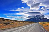 stock photo of incredible  - Incredible clouds over the mountain glaciers - JPG