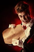 pic of dracula  - Attractive and frightening vampire holding a Sheepskin Scroll - JPG