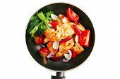 stock photo of brisket  - fried chicken brisket slices on teflon pan - JPG