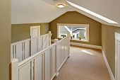 pic of upstairs  - Upstairs hallway with vaulted ceiling and skylight - JPG