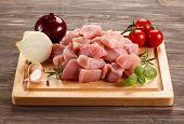image of turkey-hen  - Raw turkey meat on cutting board on wooden background - JPG