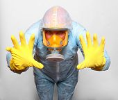 stock photo of respiration  - Man in protective clothing with respirator - JPG