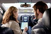 stock photo of gps navigation  - couple using gps on tablet compter to navigate in car on holiday - JPG