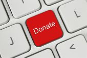 pic of soliciting  - Red donate button on the keyboard close - JPG