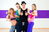 image of zumba  - Man posing with woman in zumba dance school - JPG