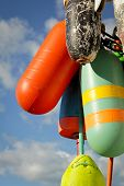 stock photo of lobster boat  - Colorful buoys with a blue sky in Maine - JPG