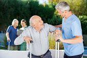 image of male nurses  - Male and female caretakers helping elderly people in nursing home - JPG