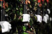 stock photo of kalashnikov  - Detail with a soldier hand on a Kalashnikov AKM rifle during a military parade