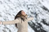 image of breathing exercise  - Fashion woman breathing fresh air in a snowy mountain in winter holidays - JPG