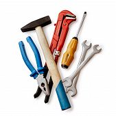 picture of tool  - Assorted DIY tools with a red mole grip or adjustable spanner pliers screwdriver and pair of spanners overhead view on white - JPG