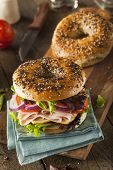 stock photo of tomato sandwich  - Healthy Turkey Sandwich on a Bagel with Lettuce and Tomato - JPG