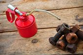picture of oil can  - Oil can on wooden background - JPG
