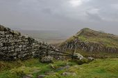 stock photo of wall cloud  - Low lying cloud gathers over Hadrians Wall - JPG