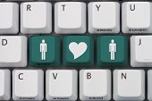 picture of hookup  - Online Dating A gray computer keyboard with man and man symbol with a heart in teal letters - JPG