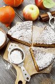 image of pumpkin pie  - Pumpkin pie with apples and cinnamon on the wooden table - JPG