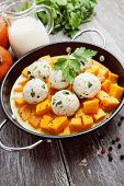 pic of saucepan  - Baked pumpkin and chicken meatballs with herbs in a saucepan - JPG