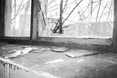picture of premises  - Broken glass at Window of old industrial urbex building
