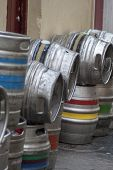 picture of keg  - Beer kegs on a side street outside a pub - JPG