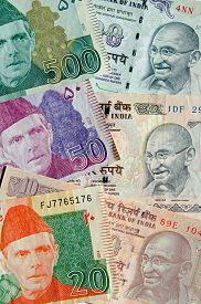 stock photo of gandhi  - Used banknotes from Pakistan and India showing the founding fathers of both nations  - JPG