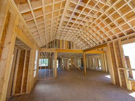 image of 2x4  - New house interior construction with 2 x 8 beams used in ceiling construction - JPG