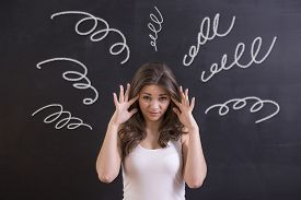 foto of confusing  - Woman is feeling confusion and chaos - JPG