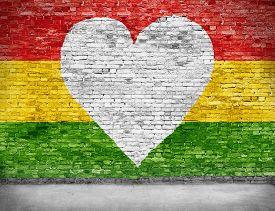stock photo of reggae  - Love for reggae music loving painted over white brick wall - JPG
