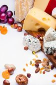 image of dry fruit  - Cheeses with dried fruits and nuts on wooden board - JPG