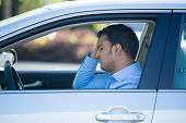 picture of pissed off  - Closeup portrait angry young sitting man pissed off by drivers in front of him hand on head - JPG
