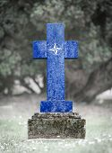stock photo of cemetery  - Old weathered gravestone in the cemetery  - JPG