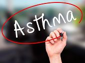 pic of asthma  - Man Hand writing Asthma with black marker on visual screen - JPG