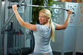 Woman At Lat Machine