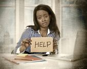 image of frustrated  - black African American ethnicity tired and frustrated woman working as secretary in stress at work business district office desk with computer laptop asking for help in frustration concept - JPG