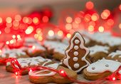 pic of christmas cookie  - Christmas Gingerbread Cookies homemade on wooden table with decoration holidays light  - JPG