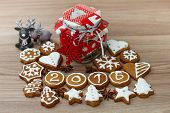picture of christmas cookie  - Christmas Gingerbread Cookies homemade with decoration on wooden table - JPG