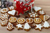 stock photo of christmas cookie  - Christmas Gingerbread Cookies homemade with decoration on wooden table - JPG