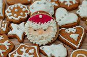 image of christmas cookie  - Christmas Gingerbread Cookies Santa Claus homemade on wooden table - JPG