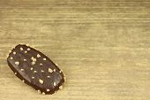 picture of icing  - Biscuit with chocolate icing on wooden background - JPG