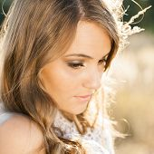 stock photo of tallgrass  - Portrait of young beautiful model at sunrise  - JPG