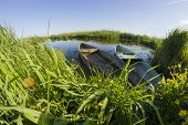 picture of old boat  - fisheye lens shot of old wooden boats on wild river - JPG