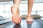 pic of treadmill  - Digital composite of Highlighted foot of woman on treadmill - JPG